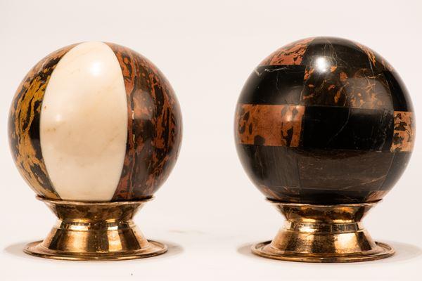 Pair of spheres in various marbles