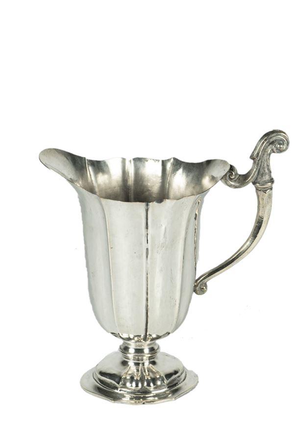 Water jug in silver metal