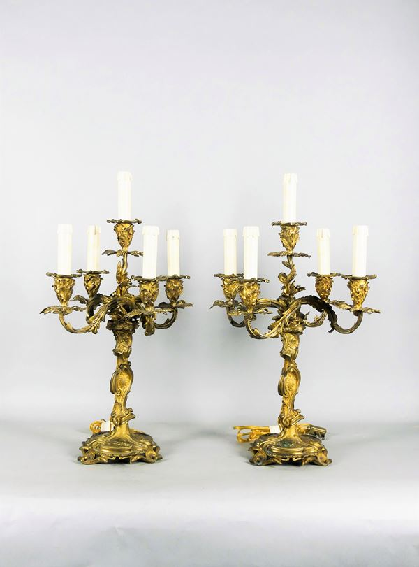 Pair of French Louis XV candelabra in gilded bronze