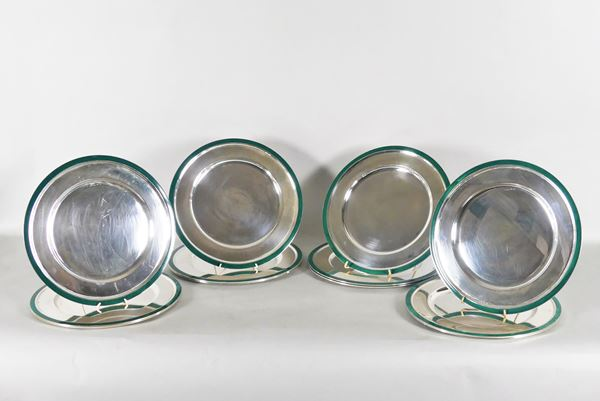 Twelve silver placemats with green enamel edges. 6680g