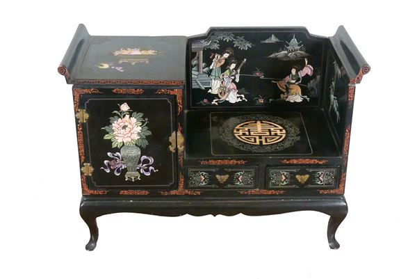 Japanese furniture in black lacquered wood with applied decorations