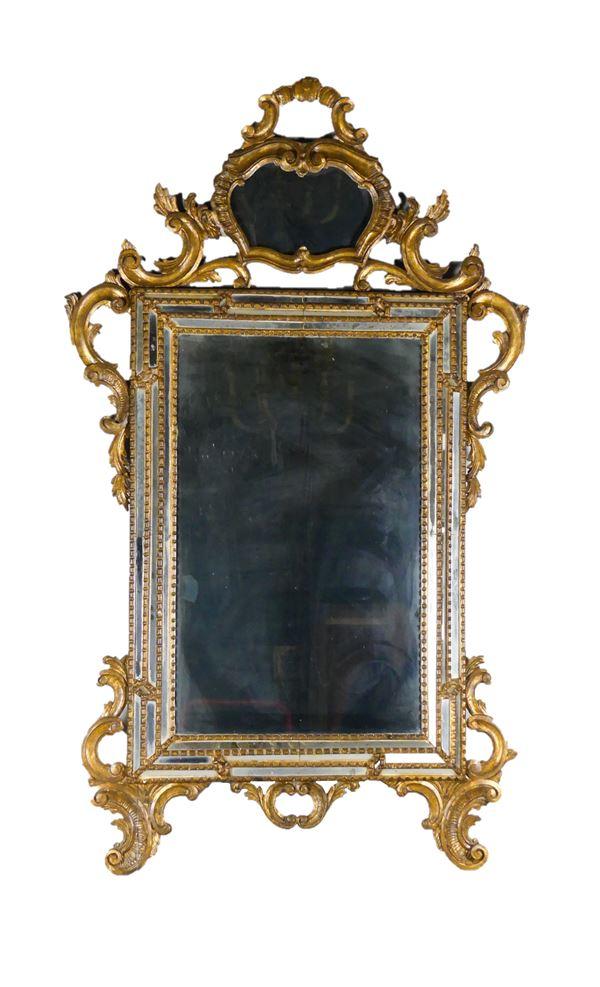 Specchiera Veneta in legno dorato di linea Luigi XV