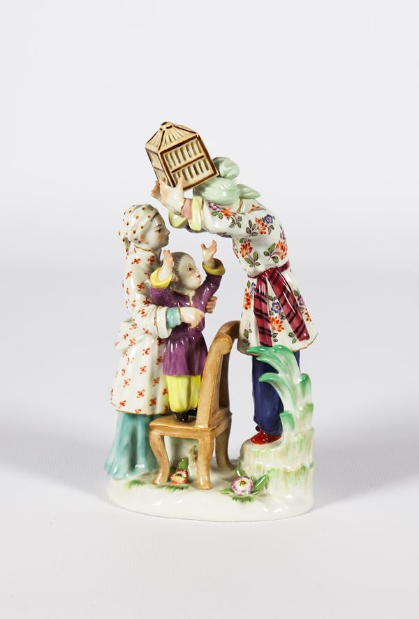 """Small group in polychrome enameled Meissen porcelain """"Chinese girl with children playing"""""""
