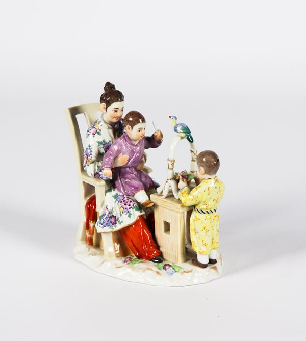 """Small group in polychrome enameled Meissen porcelain """"Chinese girl with children"""""""