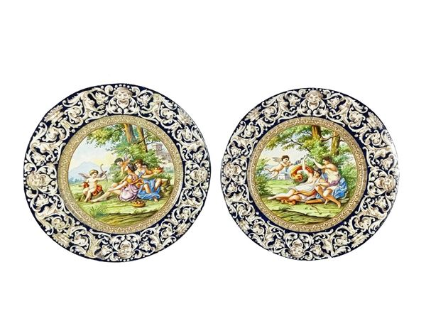 "Pair of parade plates ""Mythological Allegories"" in Capodimonte glazed majolica"