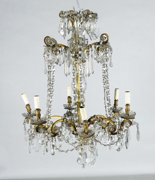 French chandelier of Louis XVI line in crystal and patinated bronze