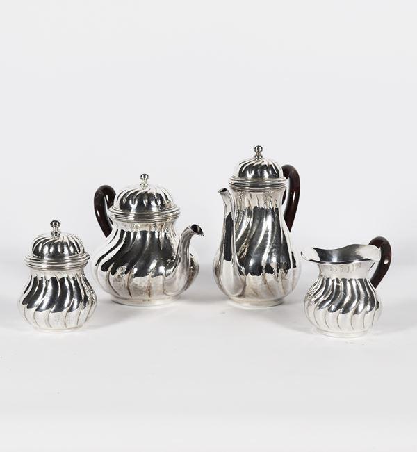 Servizio da tè e caffè in argento (4 pz). Gr. 1290