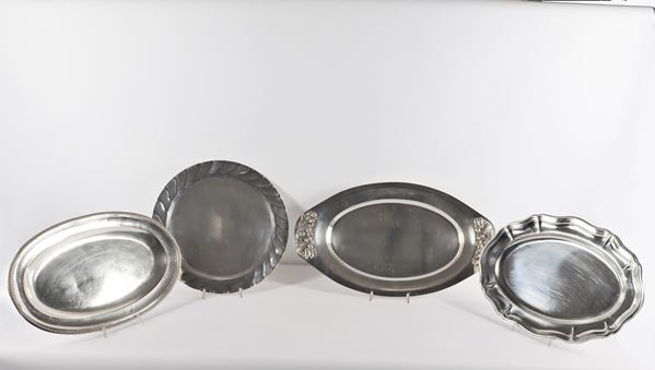 Four metal serving trays