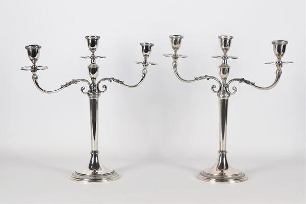 Coppia di candelabri  a tre fiamme in argento gr 1150