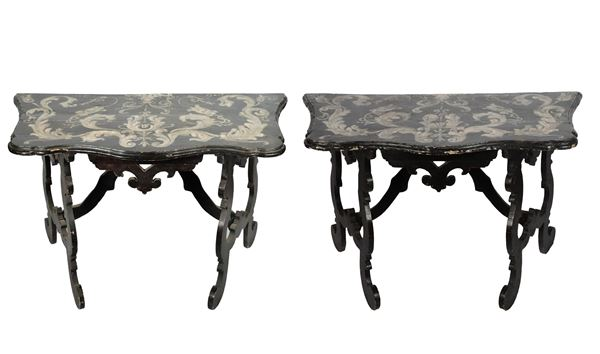Pair of antique Louis XIV line consoles in black lacquered wood