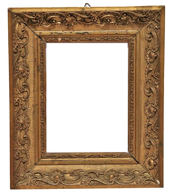 Antique small French frame in gilded and carved wood