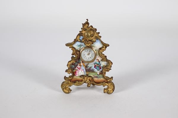 Antique small table clock in gilt bronze with enamel plate