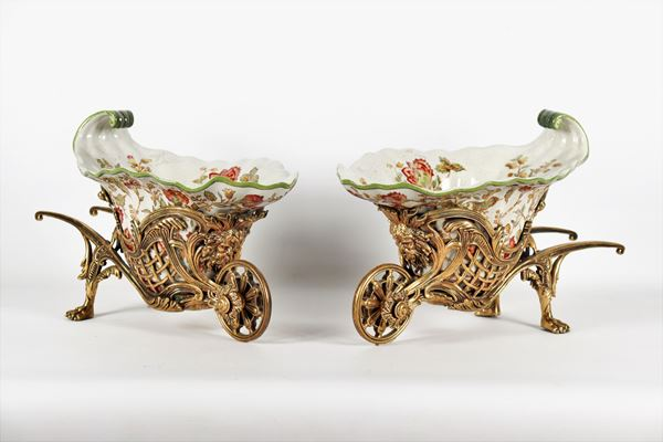 Pair of wheelbarrow planters in porcelain and gilt bronze