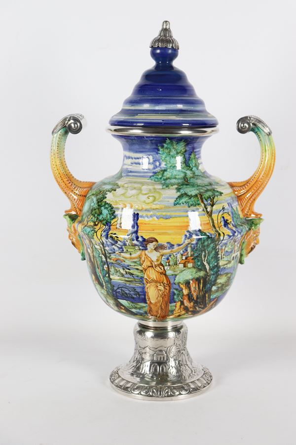 Two-handled vase in glazed majolica from Pesaro, marked Mengaroni, with base and profiles in silver