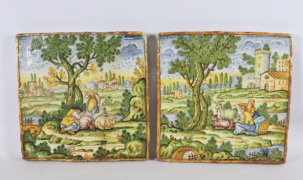 "Pair of large tiles ""Landscapes with pastoral scenes"" in glazed majolica by Castelli"