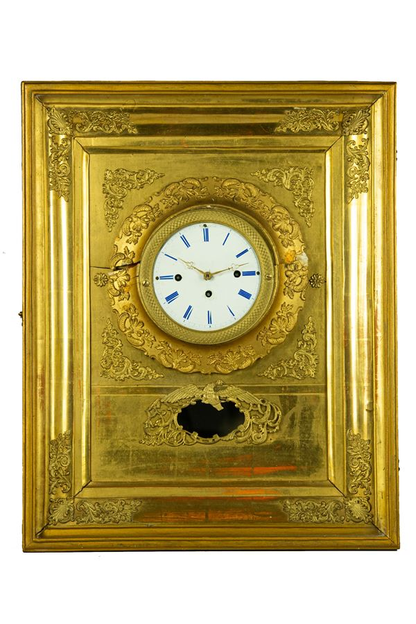 Wall clock in gilded wood