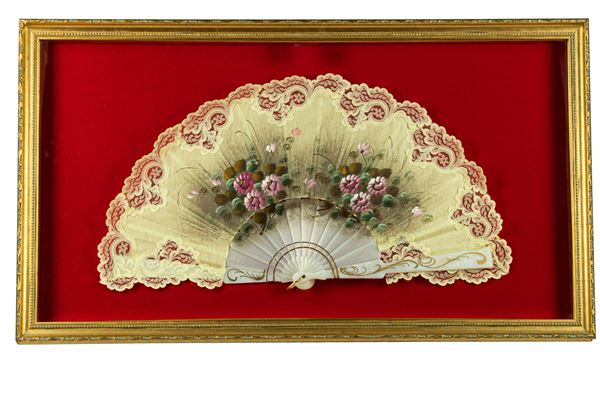 Fan decorated with floral motifs