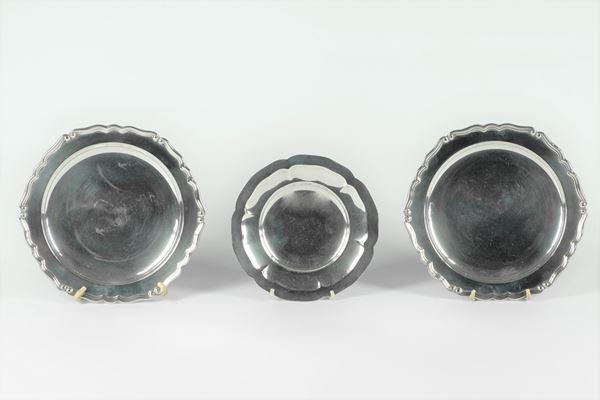 Three round silver saucers