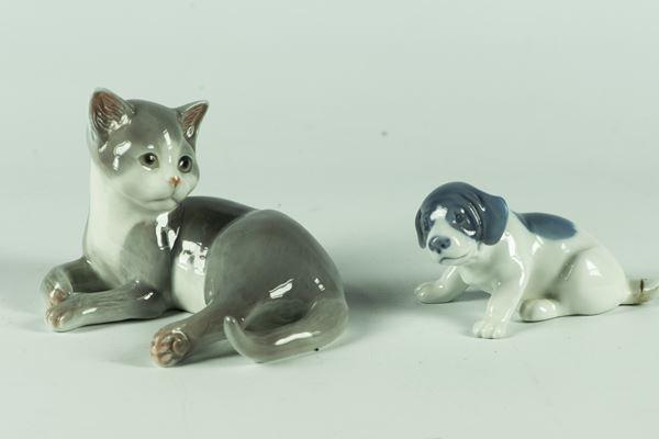 """Due Statuine """"Gatto"""" e """"Cagnolino"""" in porcellana Royal Copenhagen"""