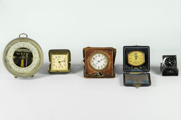 One Barometer and four travel alarm clocks with cases